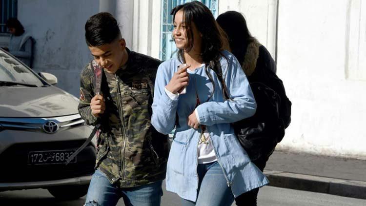 © AFP/Des jeunes Tunisiennes à la sortie de leur lycée, le 11 décembre 2017 à Bizerte